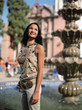 Mixed race woman standing near fountain