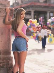 Sexy Hispanic woman wearing shorts