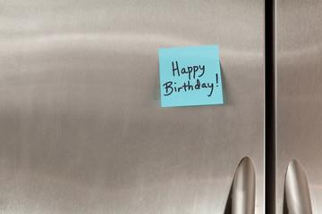 Happy Birthday sticky note on a refrigerator