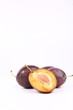 Plums on white background with space for text