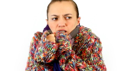 Woman in sweater embrace herself and shiver
