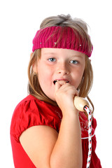 Singing girl pretending jump rope to be a microphone isolated