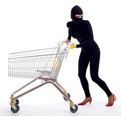 female thief in balaclava with shopping cart