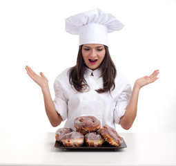 female chef in white uniform and hat with donuts