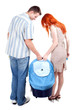young couple with part of baby buggy