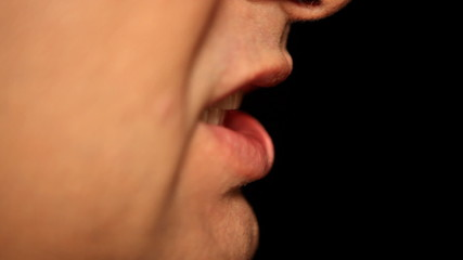 Businessmans mouth talking, extreme close-up, profile