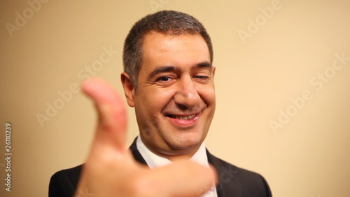 Successful businessman giving thumbs up - Achievement