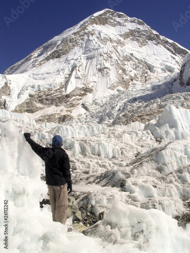 Climber stands in the Khumbu Ice-field, Mt Everest, Nepal.