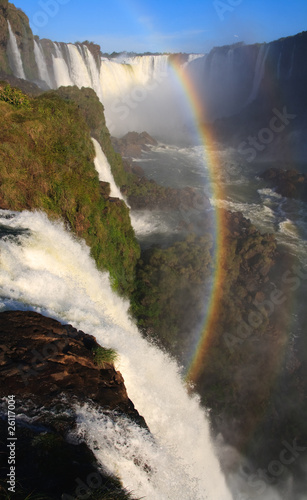 Igaucu falls with rainbow and rocks portrsit