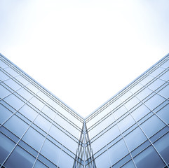 symmetric wall of glass building in haze