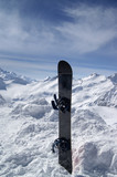 Snowboard against the hight mountains poster