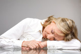 Pensioner sleeping on the table poster