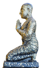 Praying monk statue cover with gold sheet on white background