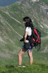 side full portrait of an woman equiped for hiking