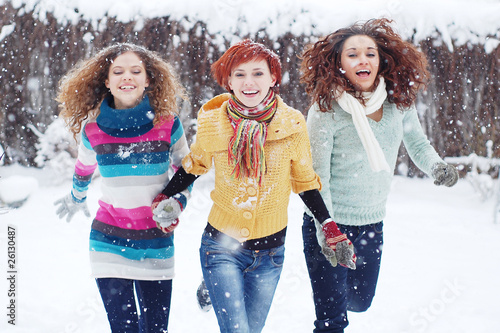 Cheerful portrait of gorgeous girls on the snow