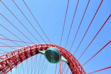 Vivid red suspension bridge