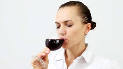 Elegant woman tasting wine