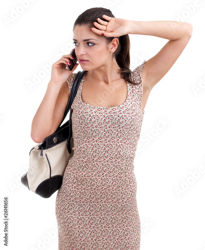 young woman speaking by a mobile phone