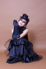 Gothic lady wearing long black leather gloves