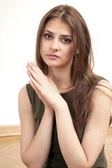 praying, thoughtful young long hair woman