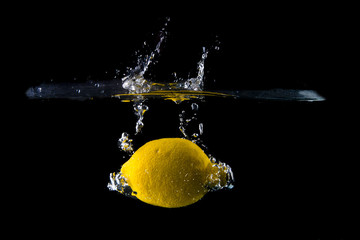 Lemon splash on black background