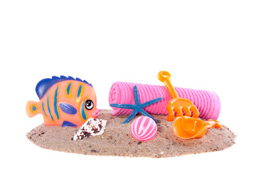 colorful beachtoys for a nice day at the beach isolate over whit