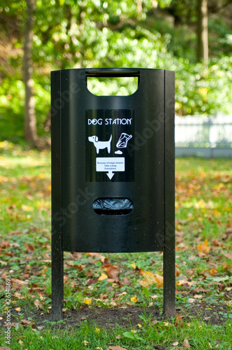 Dog waste station with instructions in the park