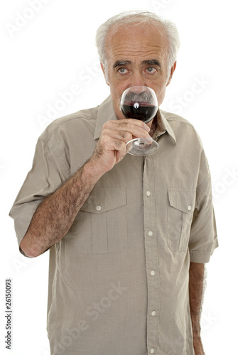 Senior man drinking a glass of red wine