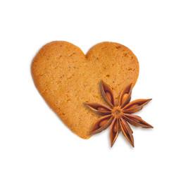heart shape xmas cake with spice anis isolated on white backgrou
