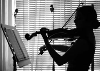 violinist plays violin