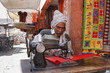 India, Rajasthan, Jaipur, indian taylor working on the street