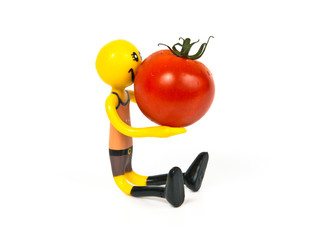 "Figure of ""smiley"" holding tomato isolated on white"