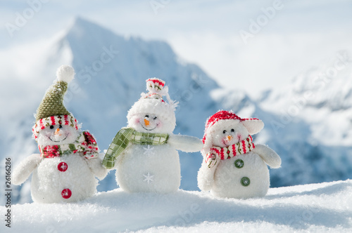 Happy snowmans in mountain Poster