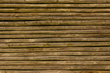 Close up of brown lath fence poster
