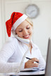 Santa helper working in office - 26181805