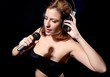 Beautiful  woman with headphones and mic singing