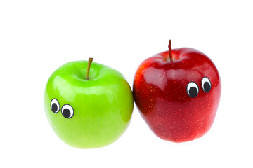 apples with eyes and faces isolated on white