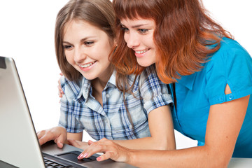 Two teen-girls with laptop