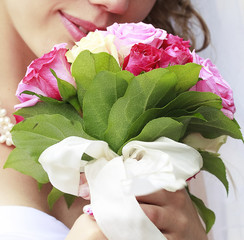 bridal bouquet in the hands of the bride