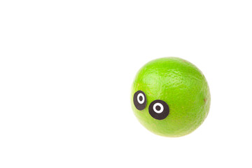lime with eyes and faces isolated on white
