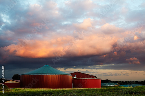 biogas plant with clouds illuminated by the sunset - 26188418