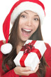 Santa hat woman holding gift excited