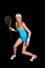 Young blond sportswoman over a black background
