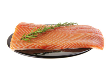 fresh uncooked red fish fillet and rosemary
