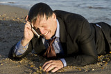 miserable crying businessman on cellphone poster