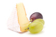 Piece of soft cheese and grape