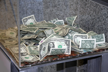 Money in a donation box