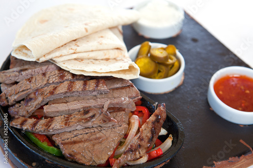 Tortillas with beef steaks and sauces