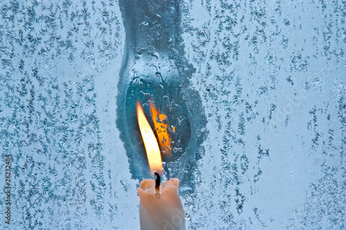 Leinwandbild Motiv melted frost pattern on window glass and candle