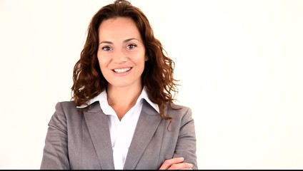 Businesswoman looking at camera with arms crossed